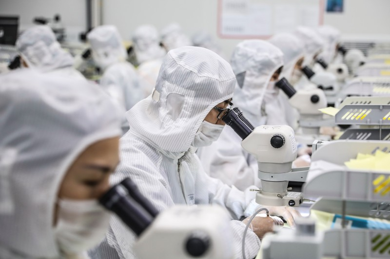 Workers producing LED chips at a factory in Huaian, in China's eastern Jiangsu province, on June 16.