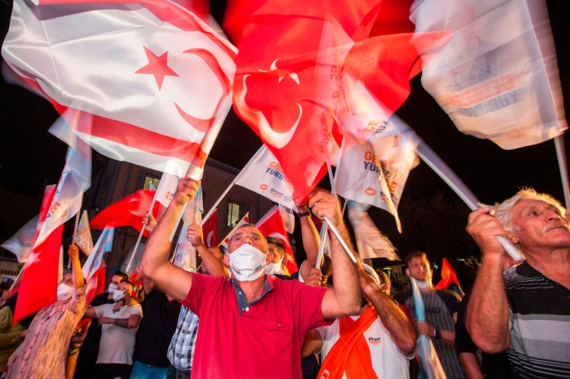 Supporters of Ersin Tatar celebrate his win in the presidential election in the northern part of Nicosia, the capital of the self-proclaimed Turkish Republic of Northern Cyprus.