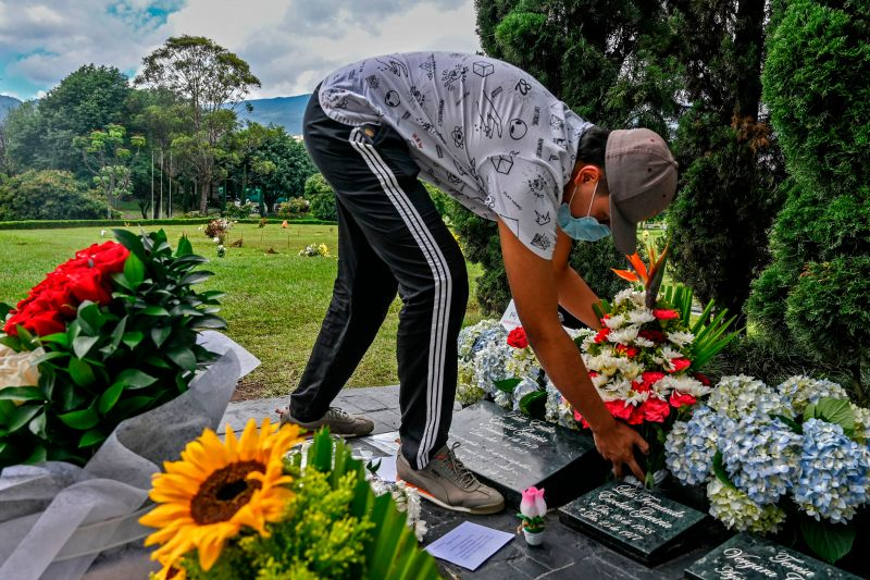 An admirer of Colombian crime boss Pablo Escobar places flowers on his grave on the anniversary of his death, at the Montesacro cemetery in Itagüí, near Medellín,  Colombia on Dec. 2.