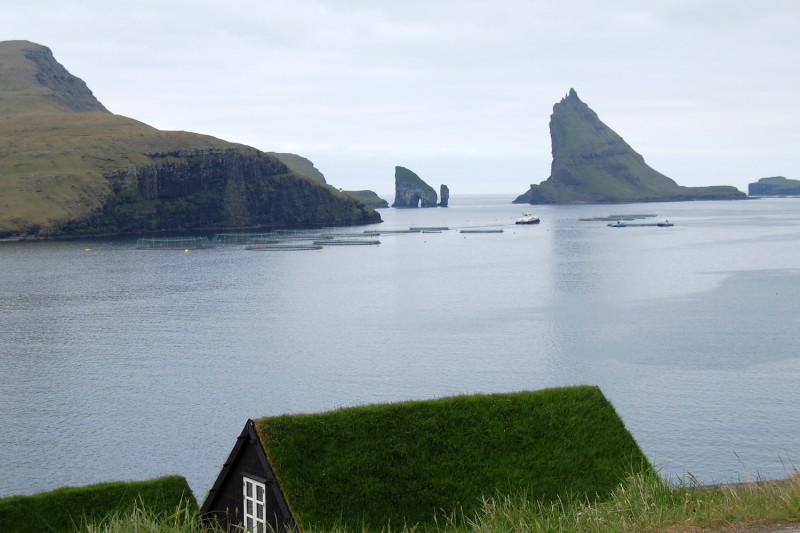 A picture taken on June 6, 2018, shows a fish farm in the Sorvagsfjorour fjord on Vagar island, one of the Faroe Islands.