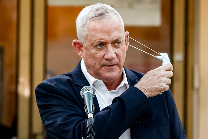 Benny Gantz takes off a mask as he gives a statement outside the city hall of Bnei Barak regarding a lockdown due to the COVID-19 coronavirus pandemic, on September 6, 2020.