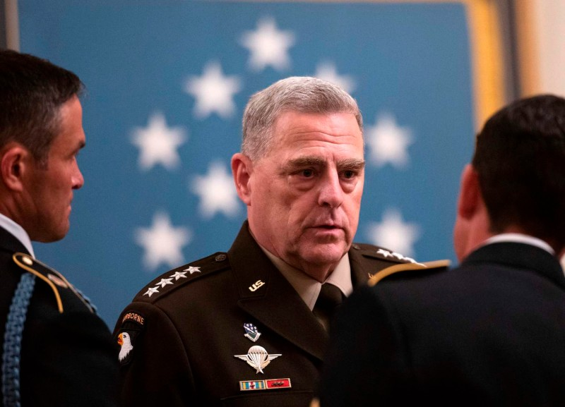 Chairman of the Joint Chiefs of Staff Mark Milley speaks with members of the military before the Medal of Honor ceremony for U.S. Army Sgt. Maj. Thomas Payne, in the East Room of the White House in Washington on Sept. 11.