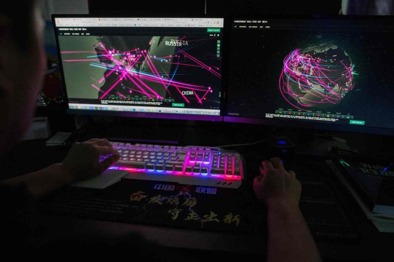 A member of the hacking group Red Hacker Alliance uses a website that monitors global cyberattacks on his computer at their office in Dongguan, China.