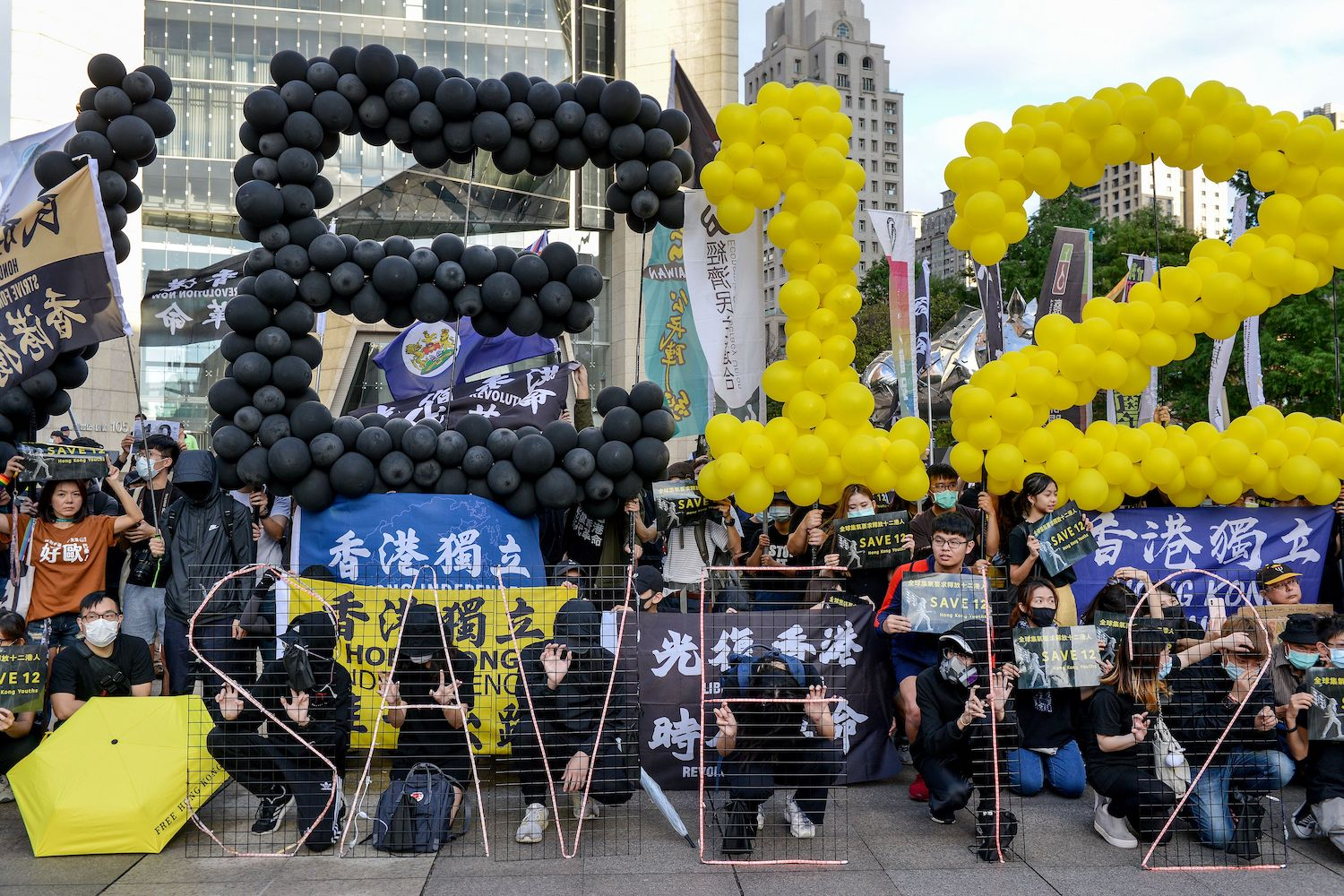 People protest in support of Save12, the campaign to save twelve Hong Kong pro-democracy activists caught by mainland Chinese authorities trying to flee Hong Kong to Taiwan by boat, in central Taipei on Oct. 25.