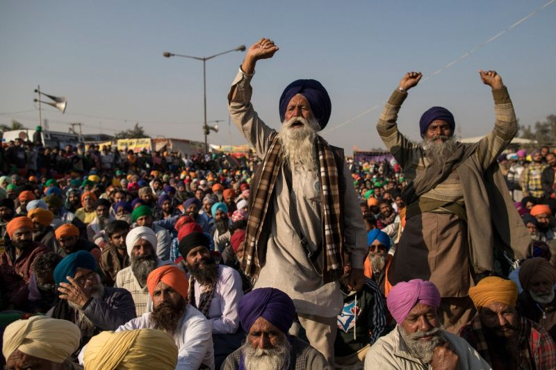 Farmers shout as they block a highway during a protest at the Singhu border near New Delhi on Dec. 18.