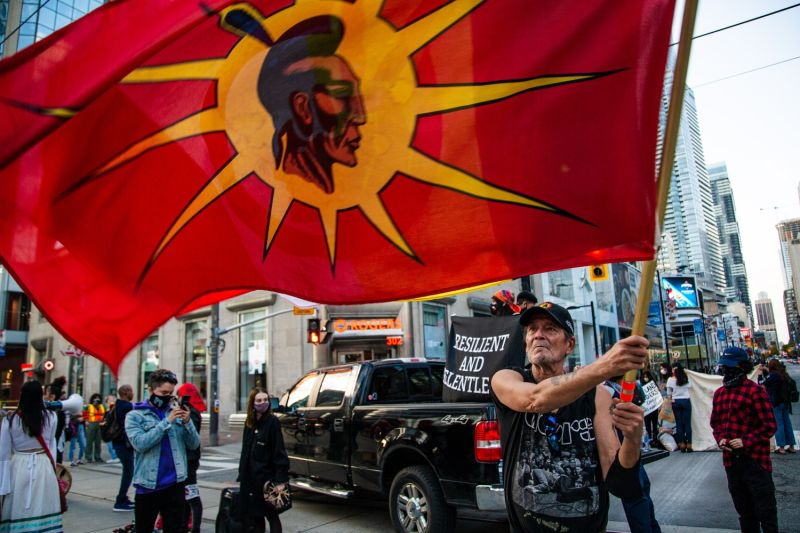 First Nations activists and allies blocked an intersection in Toronto on Oct. 23, calling on the Canadian government to uphold treaty rights, respect Indigenous sovereignty across the nation, and protect Indigenous land defenders.