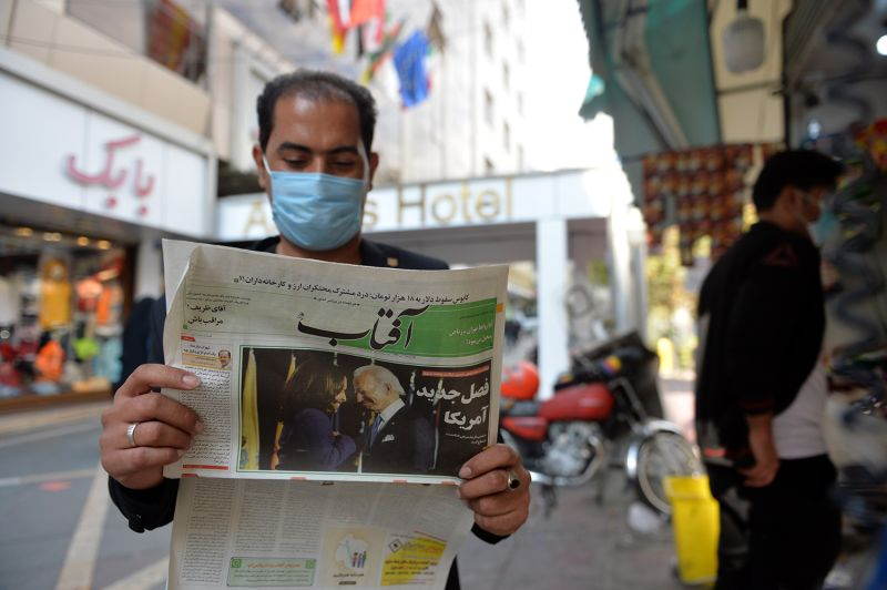 A resident reads the news about the U.S. elections in Tehran on Nov. 9.