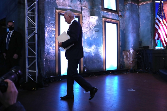 U.S. President-elect Joe Biden walks off stage in Wilmington, Delaware, on Nov. 16.