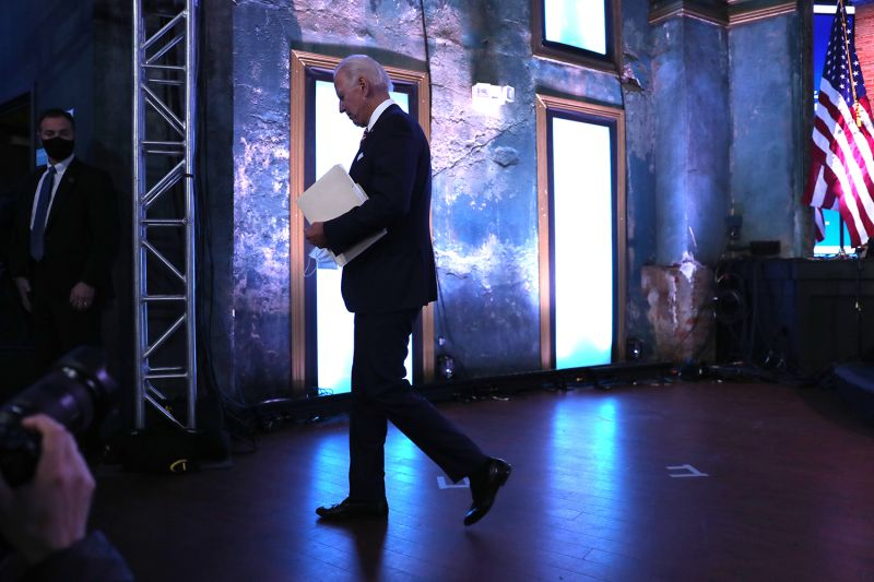 U.S. President-elect Joe Biden walks off stage in Wilmington, Delaware, on Nov. 16.