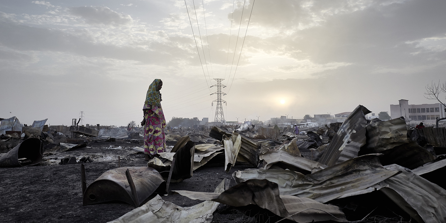 A Fulani woman observes destruction caused by the fire that ravaged the camp for displaced people in Bamako, Mali on April 28. The camp shelters more than 1,000 people who fled violence in central Mali.