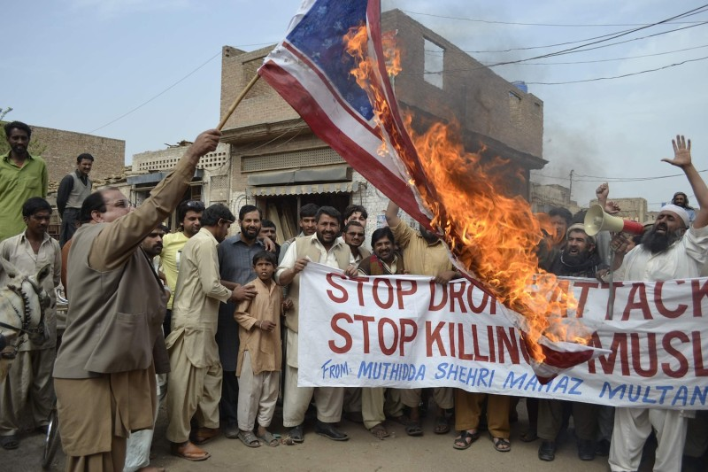 Activists burn the U.S. flag during a protest against U.S. drone attacks in Multan, Pakistan on March 14, 2012.