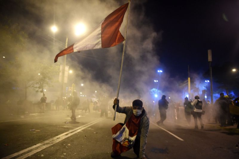 A demonstrator supporting ousted President Martín Vizcarra holds a Peruvian flag during a protest against the government of then-interim President Manuel Merino in Lima on Nov. 14.