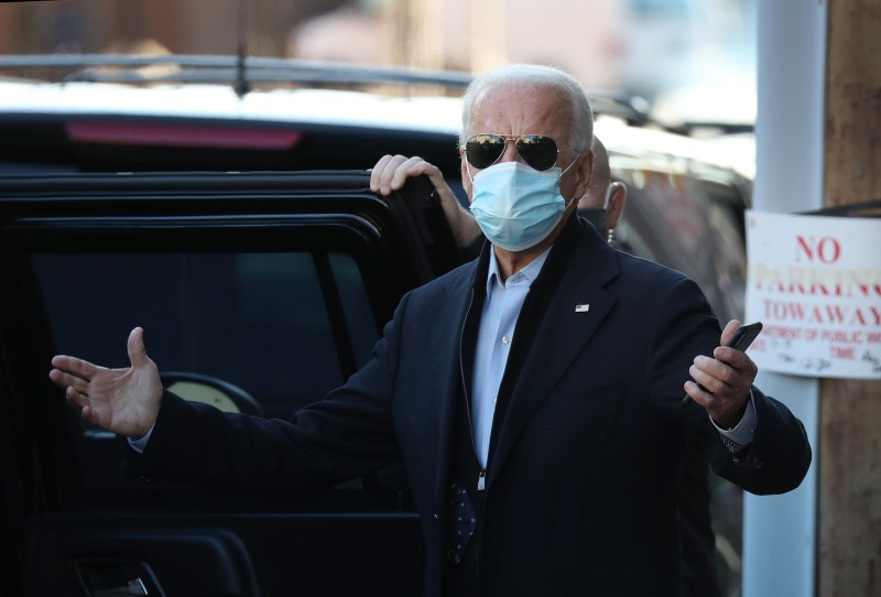 U.S. President-elect Joe Biden gestures to the media as he leaves the Queen Theater after participating in a virtual roundtable with frontline health care workers on Nov. 18, in Wilmington, Delaware.