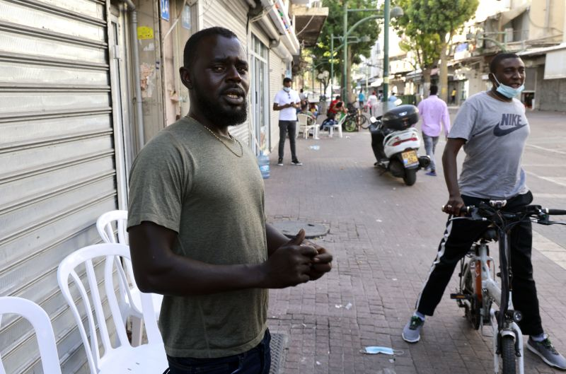 A Sudanese asylum-seeker talks during an interview in the southern part of Tel Aviv where thousands of them live, on Oct. 25.