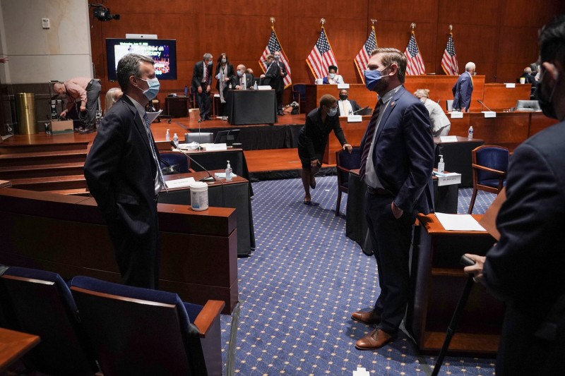 U.S. Reps. Ben Cline and Eric Swalwell talk during a break on June 17 in Washington.