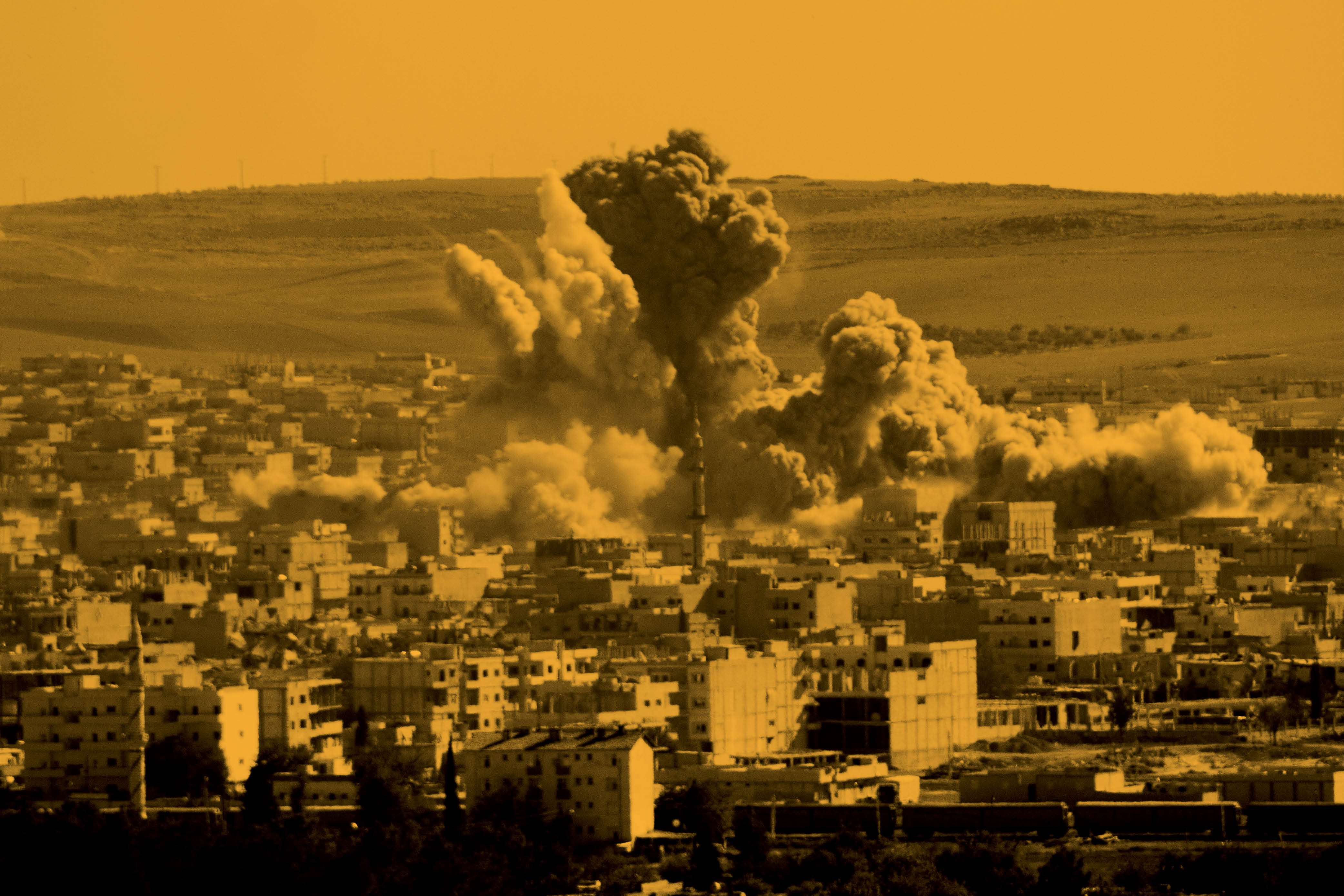 Flames rise from an explosion in the Syrian town of Kobani after a U.S.-led coalition airstrike on Oct. 22, 2014.