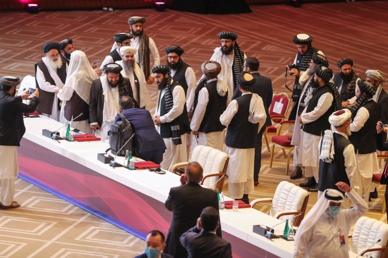 Members of the Taliban delegation leave their seats at the end of the session during the peace talks between the Afghan government and the Taliban in the Qatari capital Doha on September 12, 2020.