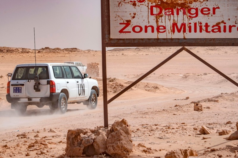 A vehicle of the U.N. Mission for the Referendum in Western Sahara drives on the Moroccan side of the border crossing between Morocco and Mauritania in Guerguerat, Western Sahara on Nov. 25.