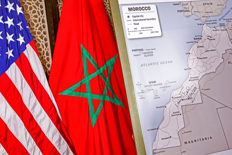 The U.S. and Moroccan and flags beside a State Department-authorized map of Morocco, including disputed Western Sahara, in Rabat on Dec. 12.