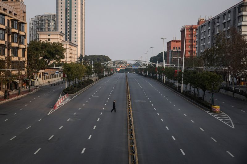 A man cross an empty highway on Feb. 3 in Wuhan, China.