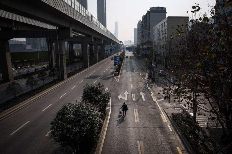 A man drags a handcart along the road on Feb. 5 in Wuhan, China.