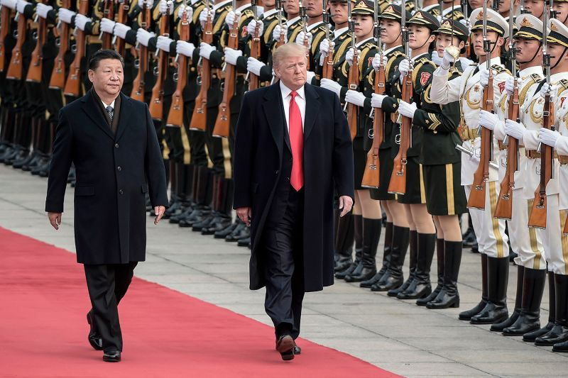China's President Xi Jinping and U.S. President Donald Trump review the Chinese honor guards during a welcome ceremony at the Great Hall of the People in Beijing on Nov. 9, 2017.