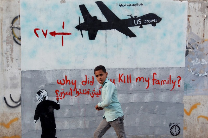 A Yemeni boy walks past a mural depicting a U.S. drone on Dec. 13, 2013 in the capital Sanaa.