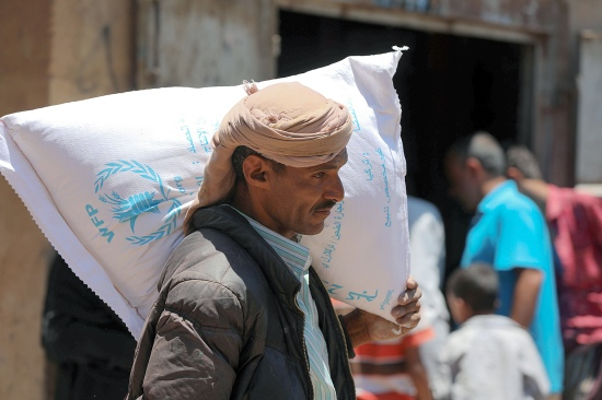 A Yemeni man receives humanitarian aid.