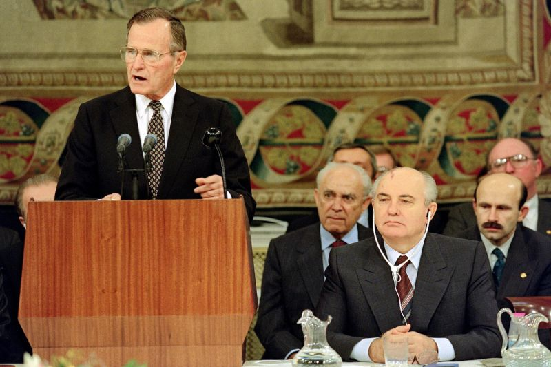 U.S. President George H.W. Bush (L) addresses delegations of the Middle East Peace Conference as Soviet counterpart Mikhail Gorbachev listens,on October 30, 1991, during the opening ceremony at the Royal Palace in Madrid, Spain.