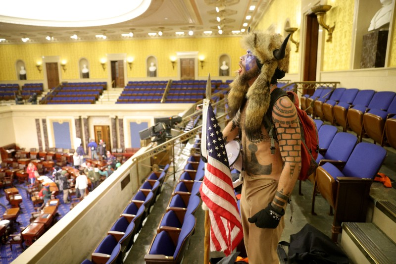 A pro-Trump rioter yells inside the Senate Chamber of the U.S. Capitol in Washington on Jan. 6.