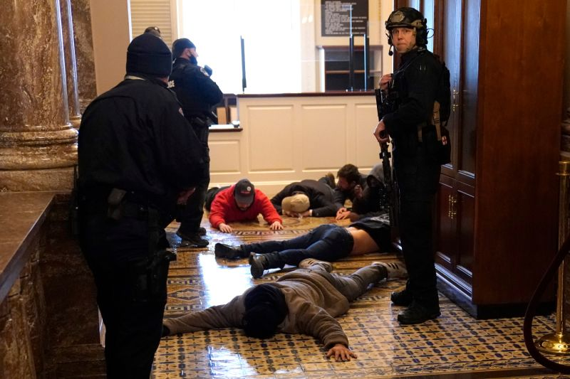 U.S. Capitol Police detain pro-Trump rioters outside the House Chamber during a joint session of Congress in Washington on Jan. 6.