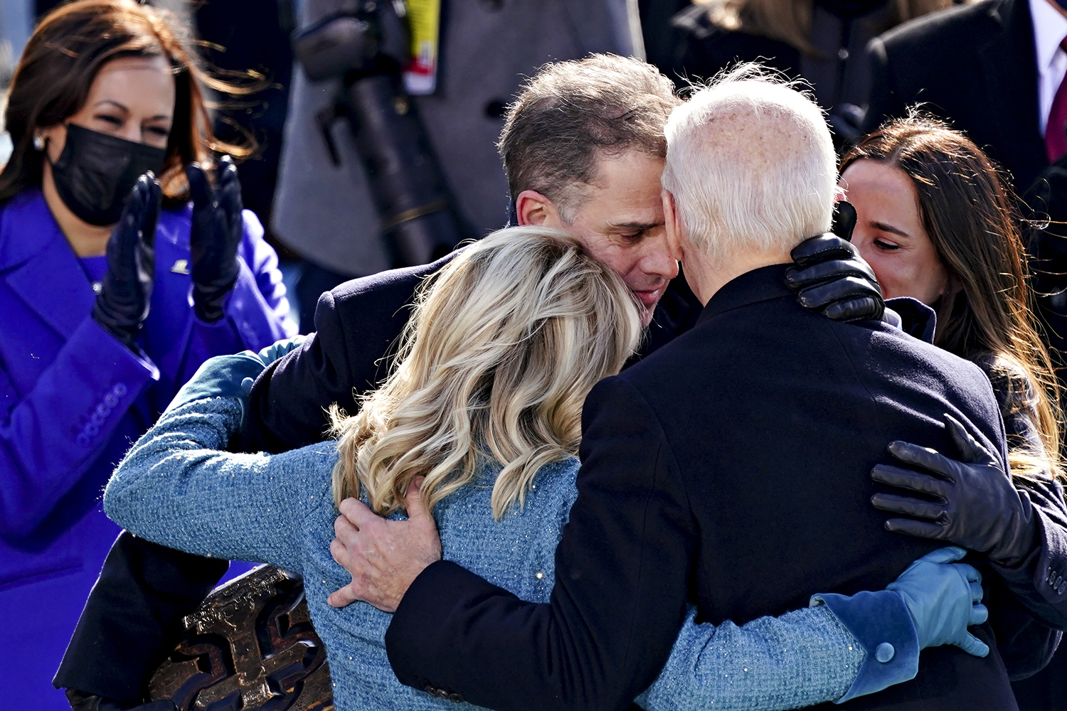 U.S. President Joe Biden, right, is embraced by his son Hunter Biden and first lady Jill Biden after being sworn in at his presidential inauguration in Washington on Jan. 20. KEVIN DIETSCH/POOL/AFP via Getty Images