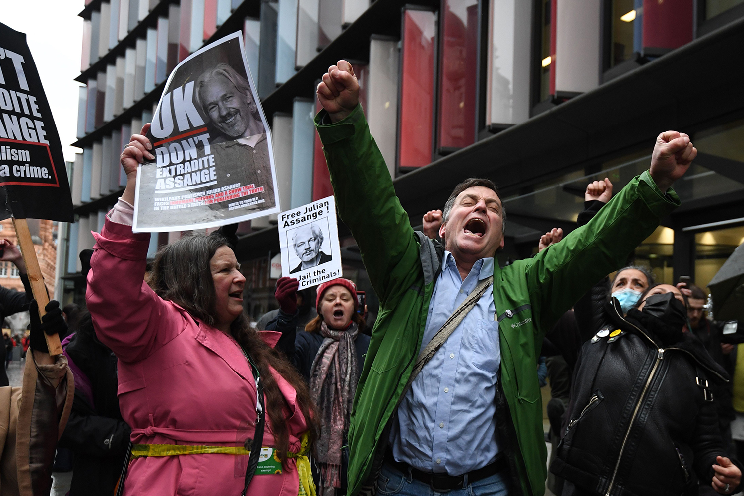 Supporters of Wikileaks founder Julian Assange celebrate outside the Old Bailey court in central London on Jan. 4 after a judge ruled that Assange should not be extradited to the United States to face espionage charges. DANIEL LEAL-OLIVAS/AFP via Getty Images