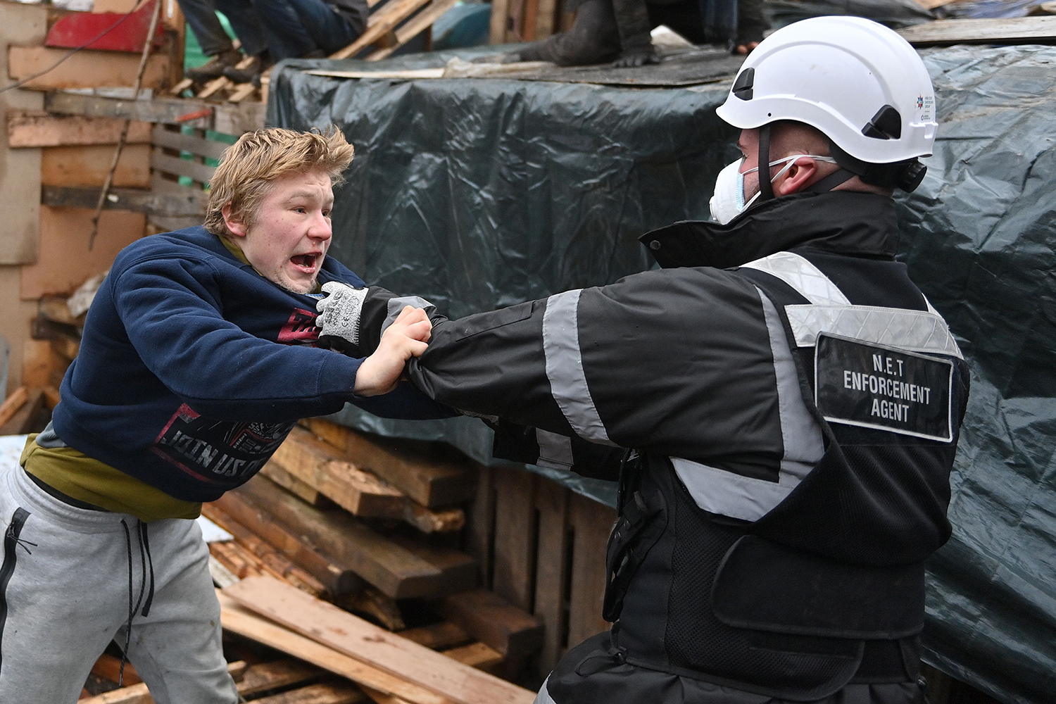 A bailiff tries to remove an activist from a protest camp against the HS2 high-speed rail line, near Euston train station in central London, on Jan. 27. JUSTIN TALLIS/AFP via Getty Images