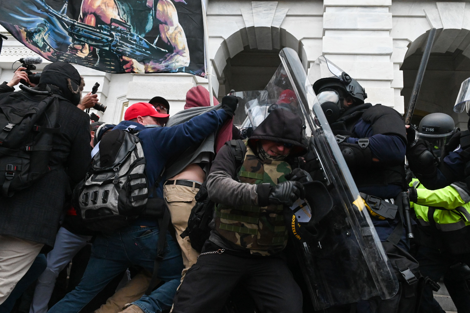 Riot police push back a crowd of supporters of U.S. President Donald Trump at the Capitol