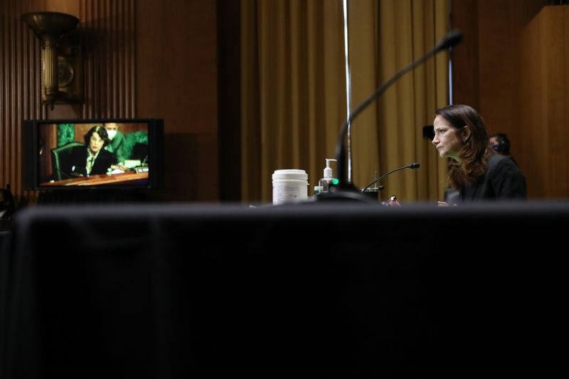 Avril Haines listens as Sen. Dianne Feinstein asks a question during her confirmation hearing before the Senate Intelligence Committee to be President-elect Joe Biden's director of national intelligence in Washington on Jan. 19.