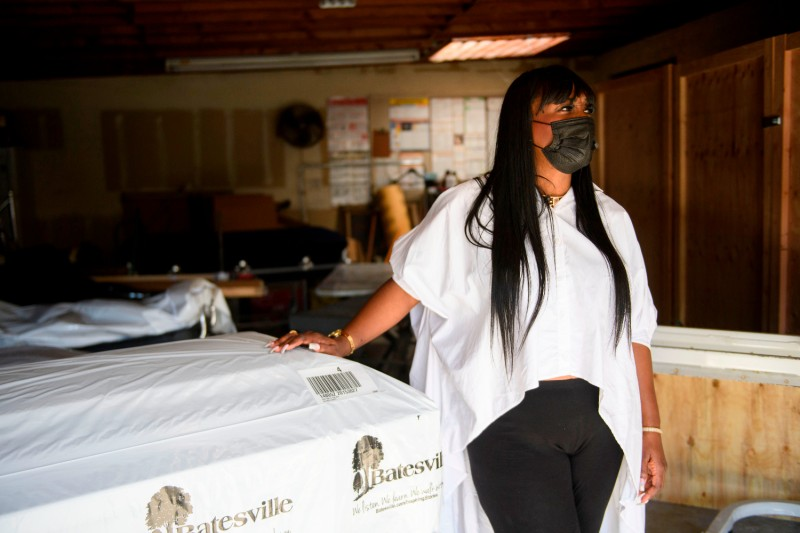 Candy Boyd, owner of the Boyd Funeral home, speaks during an interview next to an empty casket and cabinets built for expanded storage capacity of embalmed bodies awaiting burial due to the surge of Covid-19 deaths on Jan. 14, 2021 in Los Angeles.