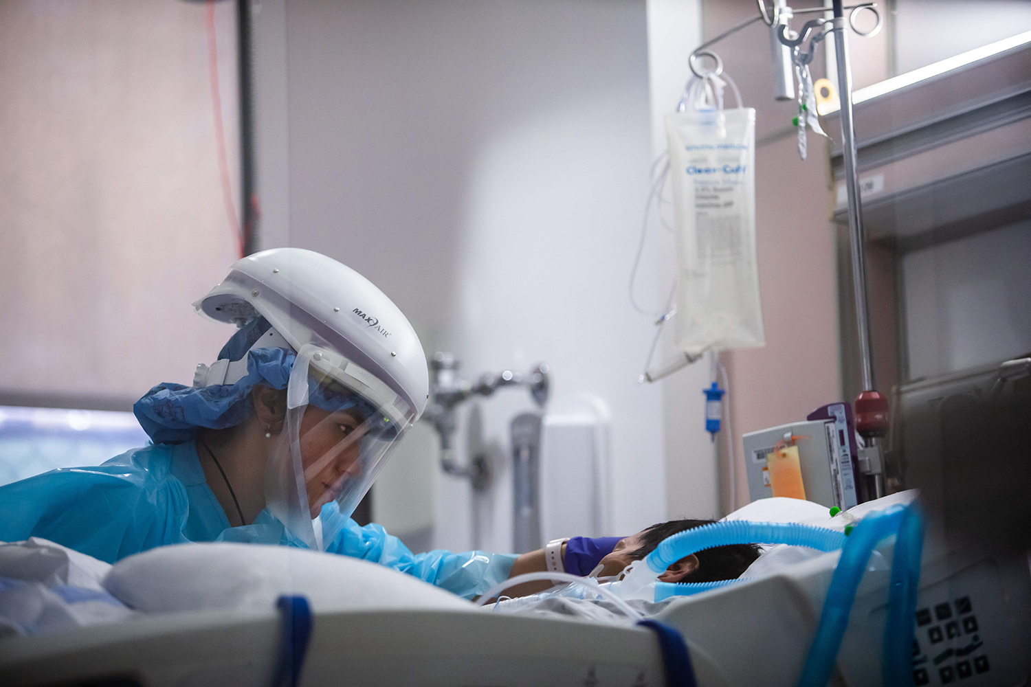 Yeni Sandoval, a registered nurse, cares for a COVID-19 patient in the ICU of Providence Cedars-Sinai Tarzana Medical Center in Tarzana, California, on Jan. 3. APU GOMES/AFP via Getty Images