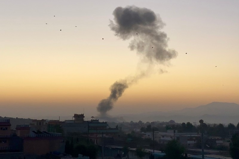 A plume of smoke rises over Khost city moments after a car bomb detonated at the gates of an Afghan National Security Forces base on Oct. 27, 2020, leading to an eight-hour battle between Afghan forces and unknown attackers part of a spate of violence in the region near Camp Chapman.