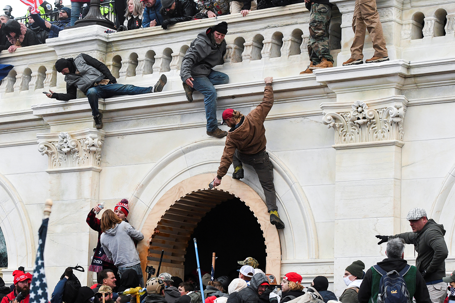 Insurrectionists climb the walls of the U.S. Capitol in Washington during a riot seeking to cancel the certification of the 2020 U.S. presidential election results Jan. 6. Stephanie Keith/Reuters