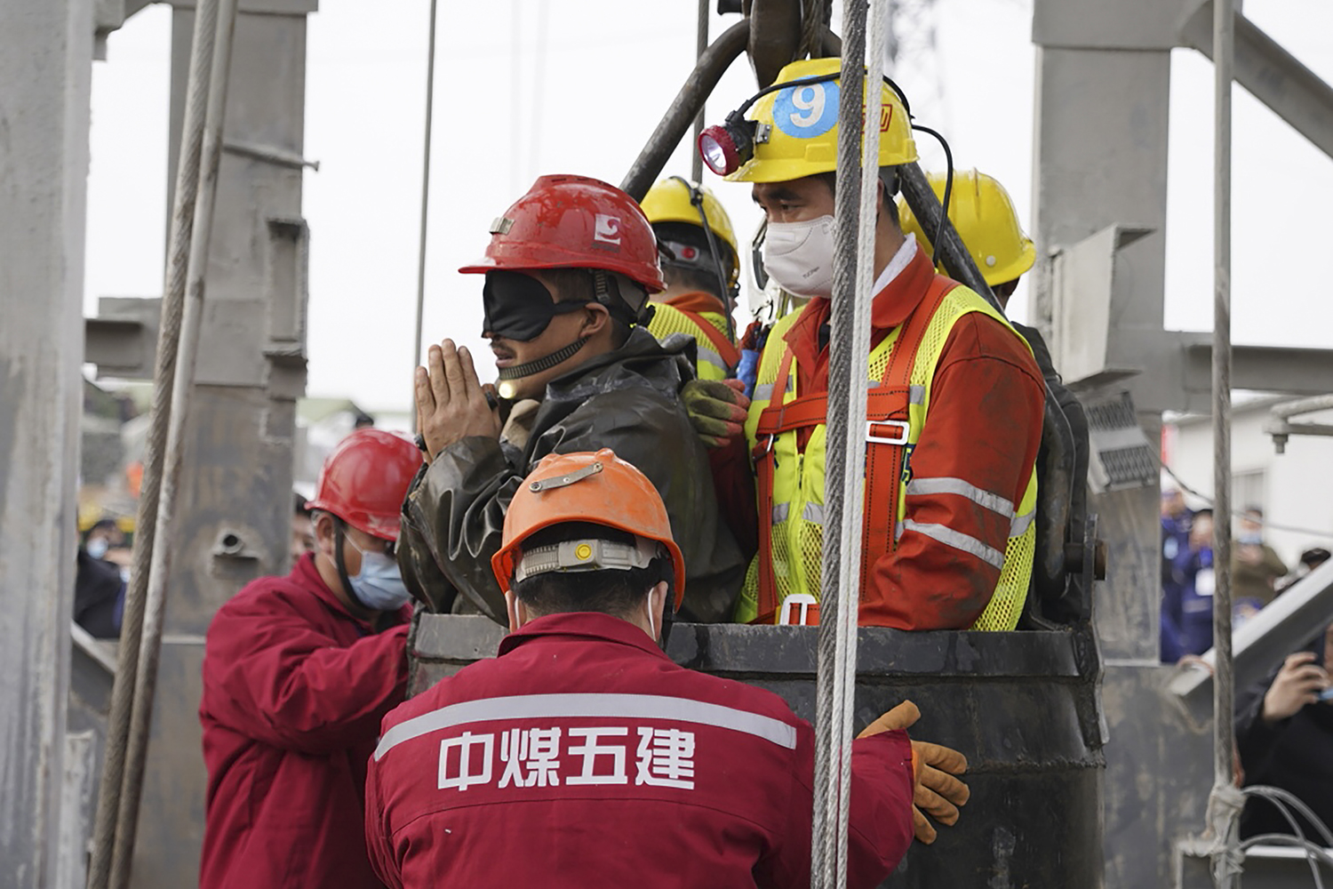 One of 22 Chinese miners trapped for two weeks after a gold mine explosion is saved in Qixia, in eastern China's Shandong province, on Jan. 24. At least 10 miners died. STR/CNS/AFP via Getty Images