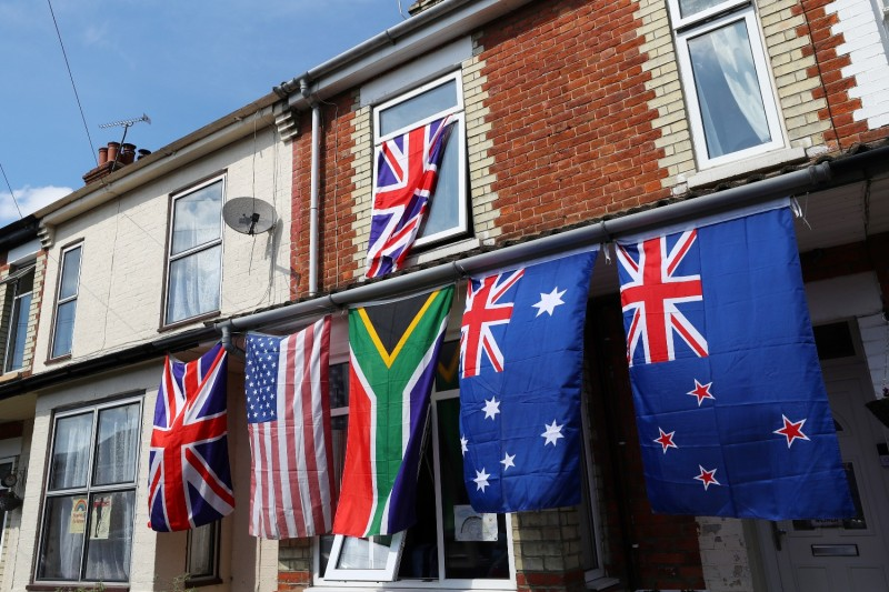 Flags of different countries hang from a house  in Aylesbury, United Kingdom, on May 8, 2020.
