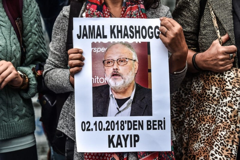 "A woman holds a portrait of missing journalist and Riyadh critic Jamal Khashoggi reading ""Jamal Khashoggi is missing since October 2"" during a demonstration in front of the Saudi Arabian consulate in Istanbul on Oct 9, 2018."