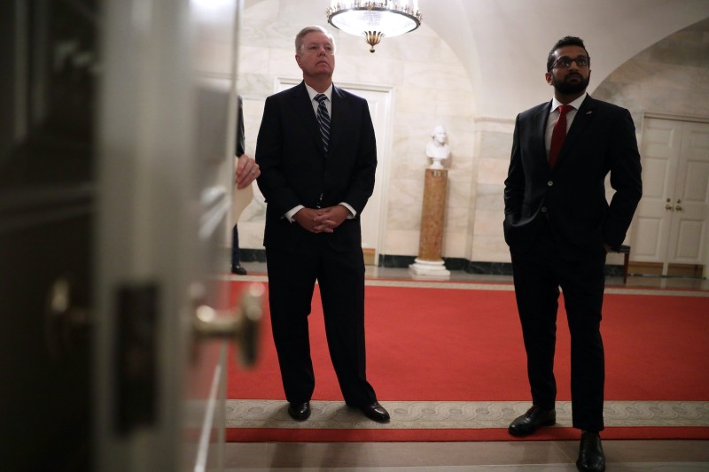 U.S. Sen. Lindsey Graham (left) and then-National Security Council Senior Director of Counterterrorism Kash Patel