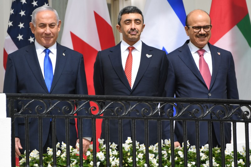 Israeli Prime Minister Benjamin Netanyahu, UAE Foreign Minister Abdullah bin Zayed Al-Nahyan and Bahrain Foreign Minister Abdullatif al-Zayani pose before they participate in the signing of the Abraham Accords where the countries of Bahrain and the United Arab Emirates recognize Israel, on the South Lawn of the White House in Washington on Sept. 15, 2020.