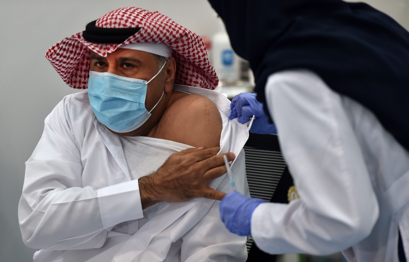 The first Saudi citizen preparing to receive the Pfizer-BioNTech COVID-19 coronavirus vaccine in the capital Riyadh on Dec. 16, 2000, as part of a vaccination campaign by the Saudi health ministry.