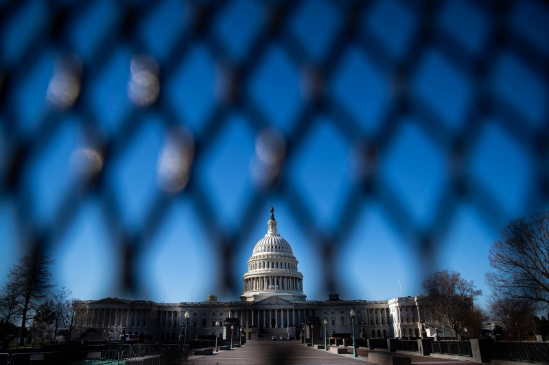 The U.S. Capitol, behind security fencing, on Jan. 10, 2021 in Washington.