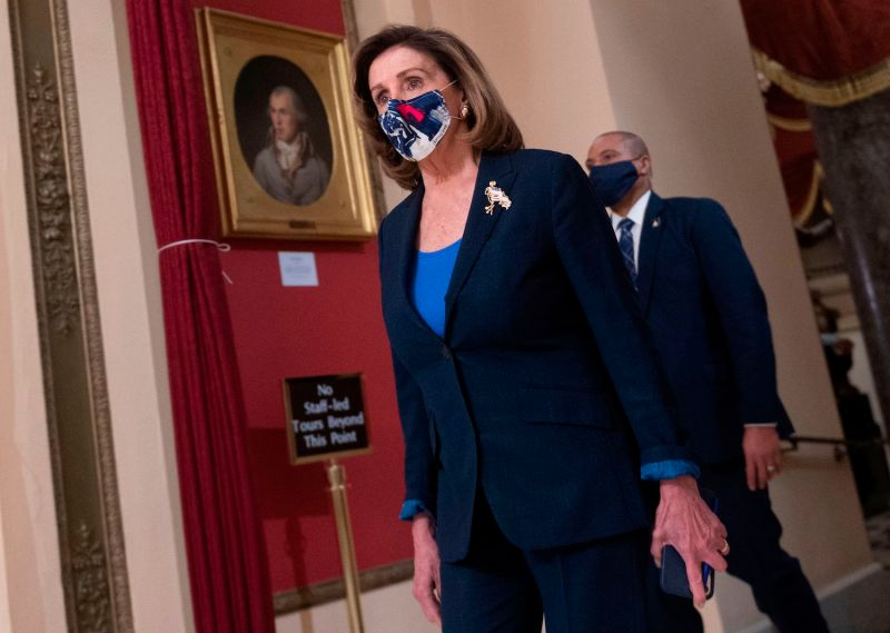 U.S. House Speaker Nancy Pelosi walks to House chambers as Congress considers impeachment against Trump.