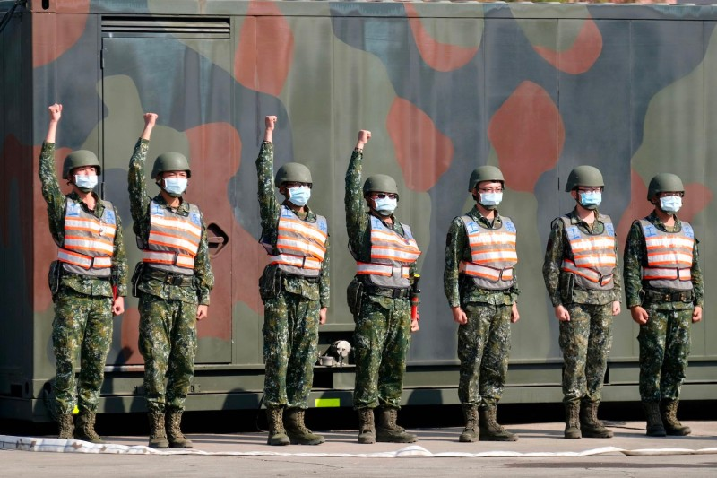 Taiwan's chemical corps personnel stand in formation during a demonstration as Taiwan's President Tsai Ing-wen inspects troops in Tainan, southern Taiwan, on January 15, 2021.