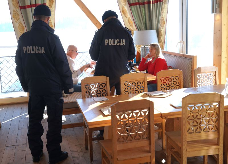 Police control people in the restaurant Schronisko Smakow, on Jan. 18, 2021 at Bukowina Tatrzanska in the Tatra mountains, which was opened on Jan. 17 despite the lockdown.